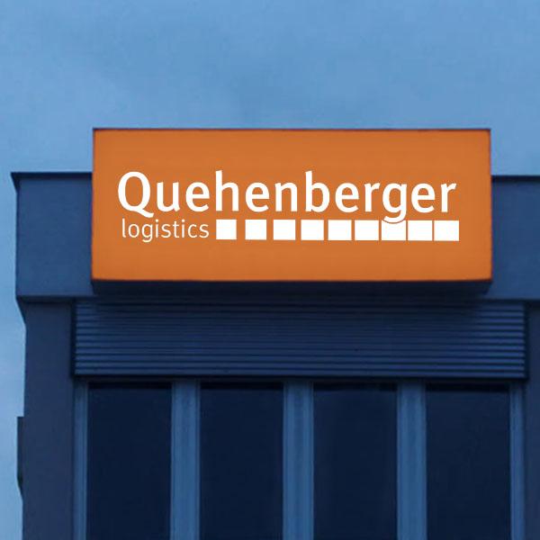 Quehenberger - Leuchtkasten mit Firmenlogo